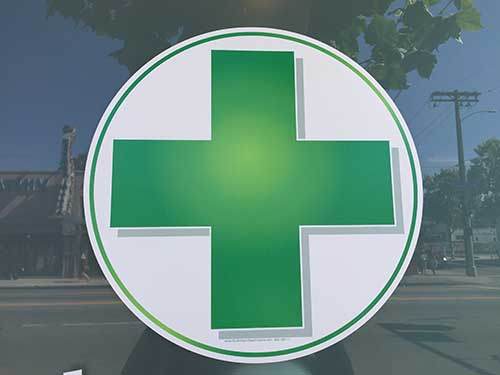 Green plus sign representing medical marijuana use