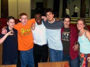 Group of diverse youth arm in arm
