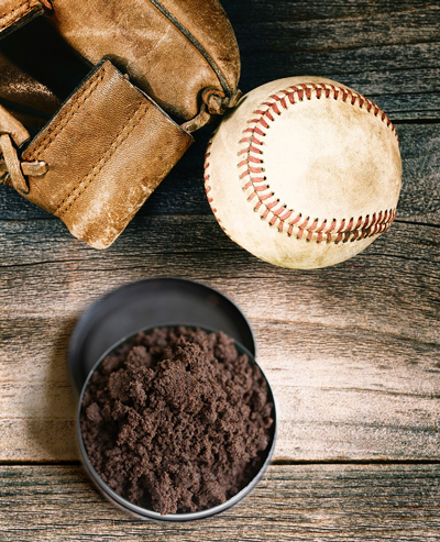 Photo of a baseball, glove and chewing tobacco