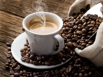 Image of a coffee cup and coffee beans