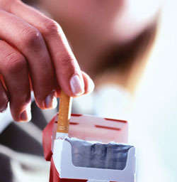 Cigarette being removed from pack