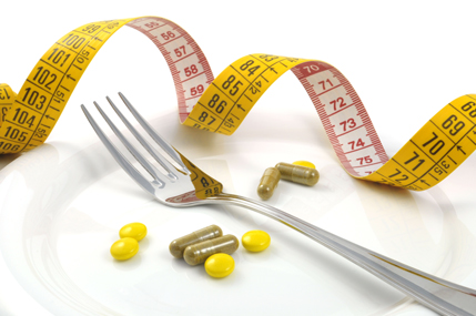 Diet pills and a tape measure