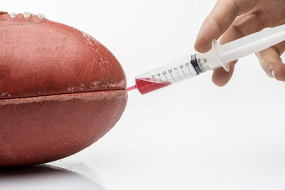 Illustration of a football being injected with drugs