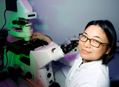 A woman scientist and a microscope