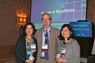 From left, Min Zhao, China; NIDA International Program Director Steven W. Gust, Ph.D.; and Yih-Ing Hser, UCLA.