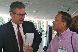 "NIDA AIDS Research Program Director Jacques Normand, Ph.D., and Yu ""Woody"" Lin, Ph.D., NIDA Division of Clinical Neuroscience and Behavioral Research"
