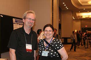 NIDA International Program Director Steven W. Gust, Ph.D., and Nathalie Gendron, Canadian Institutes of Health Research