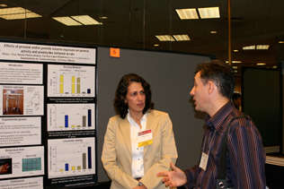 Silvia Cruz (1996-97 INVEST Fellow - Mexico) speaking with Carlos Zubaran (2009 DISCA)