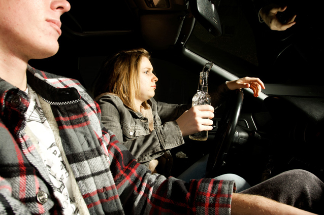 Photo of a young man drinking and driving