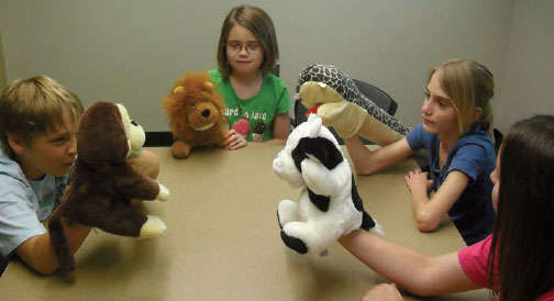 photo of children with puppets
