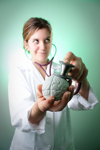 Illustration of doctor listening to a brain with a stethoscope