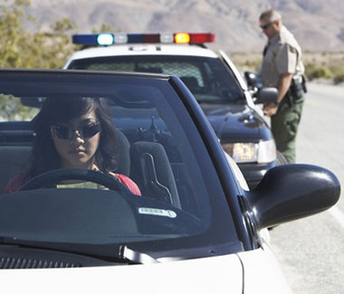 A woman in a car being stopped by police