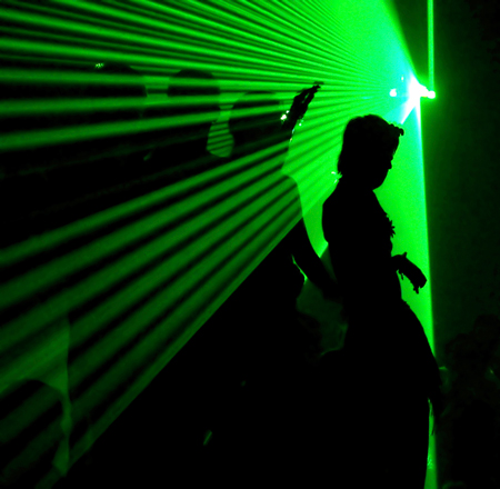 Photo of people dancing with laser lights
