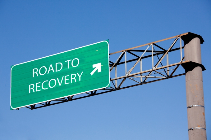 Highway sign that says Road to Recovery