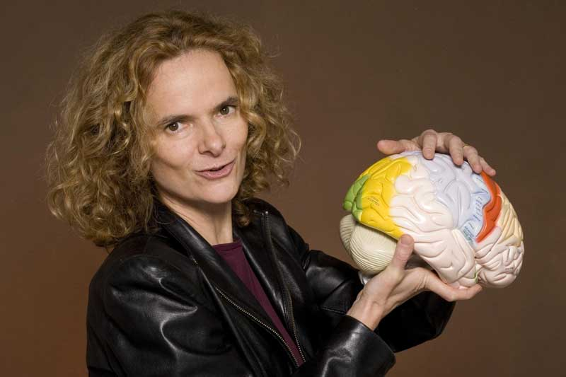 Dr. Nora Volkow holding a model of a brain