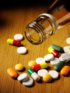 a group of colorful pills on a table