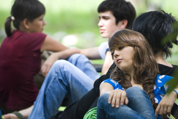 A group of teens relaxing outdoors
