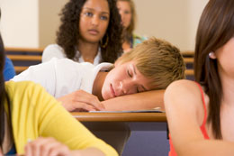 male student sleeping in class