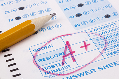 Image of a test paper with an A+ on it