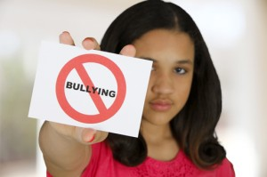 Girl holding a stop bullying message