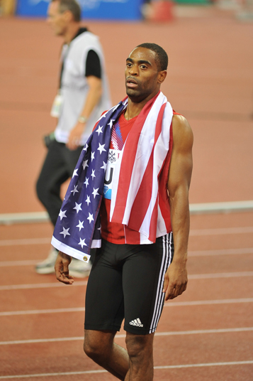 Photo of an athlete draped in an American flag