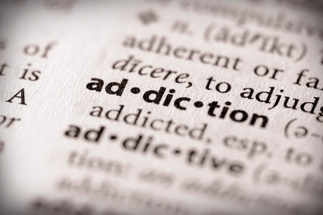 Photo of the word addiction in the dictionary