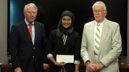 Zarin Rahman receives her 1st place award from Friends of NIDA's Charles O'Keefe (L) and Bill Dewey (R).